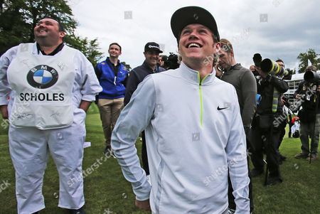 Niall Horan of One Direction looks up to the crowd after his round and talks to Jimmy Bullard.