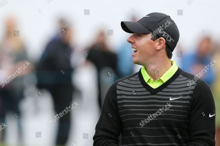 Rory McIlroy looking up at Jimmy Bullard in Stand on 18th Green