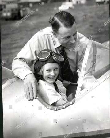 Donald Robertson With His Daughter Jane During The National Air Races At Southend.