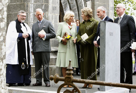 The Very Rev. Arfon Williams, Prince Charles and Camilla Duchess of Cornwall, Former President of Ireland Mary McAleese, Martin McAleese, and Minister of Foreign Affairs Charlie Flanagan at the final resting place of W.B. Yeats at St. Columba's Church in Drumcliffe, Co. Sligo on the second day of a royal four day visit to Ireland