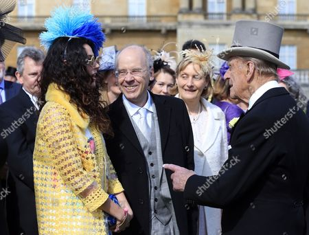 Prince Philip speaks to Eliza Doolittle (left) during a garden party held at Buckingham Palace, central London