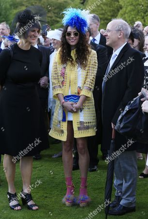 Eliza Doolittle (centre) attends a garden party held at Buckingham Palace, central London