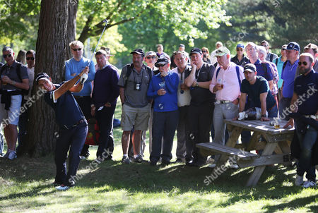 Stock Image of Eduardo Molinari plays from the spectator area during the opening round of the BMW PGA Championship.
