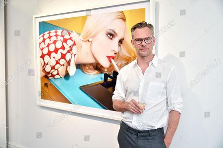 Miles Aldridge with his photograph