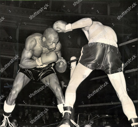 Stock Picture of Middleweight Boxing Match: Rubin Carter (left) V Harry Scott At The Royal Albert Hall. Box 0563 140515 00316a.jpg.