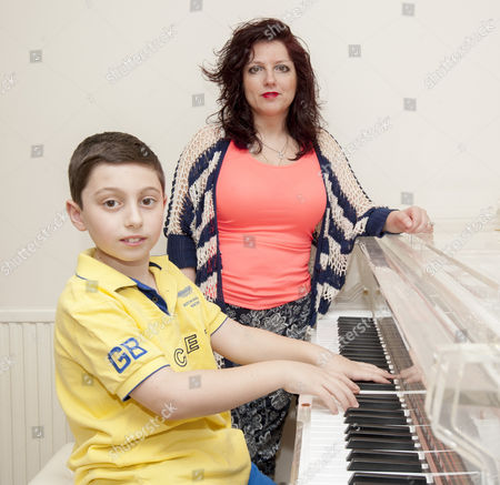 Ten Year Old Curtis Elton Who Has Been Rejected By 'britain's Got Talent' Despite Receiving 4 'yes' Votes From The Judges With His Mother Hayley At Their Home In North London. 04.5.14 Reporter Simon Cable.