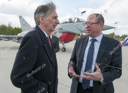 Secretary Of State For Defence Philip Hammond With British Ambassador To Lithuania David Hunt At The Siauliai Air Force Base In Lithuania Where Four Raf Tornado Aircraft Have Been Stationed. 02.5.14 Reporter Ian Drury.