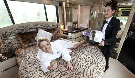 Femail Special On Writer Pertronella Wyatt Who Visits The 7 Star Camper Van. Petronella Wyatt In The Bedroom With Butler Lia Aroro Waiting On Her Every Need. 1.5.14.