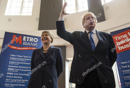Editorial photo of Boris Johnson and Angie Bray speaking to local business owners at Metro Bank in Ealing, London, Britain - 08 Apr 2015
