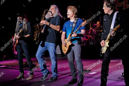 (L-R) Patrick Simmons, Marc Russo, Tom Johnston and John McFee of The Doobie Brothers perform at the Majestic Theater on April 24, 2015 in San Antonio, Texas.