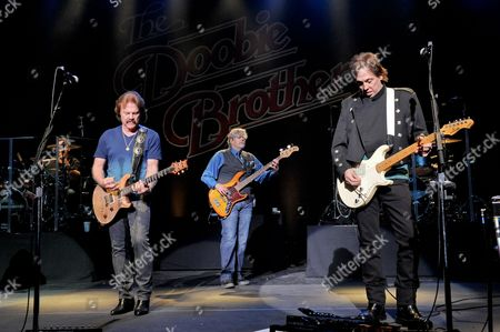 (L-R) Tom Johnston, John Cowan and John McFee of The Doobie Brothers perform at the Majestic Theater on April 24, 2015 in San Antonio, Texas.
