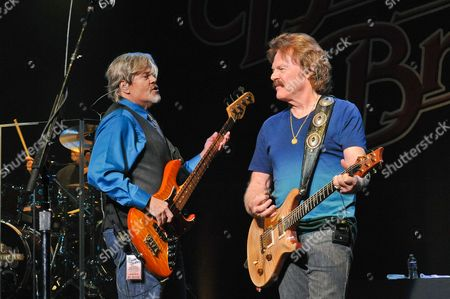 John Cowan (L) and Tom Johnston of The Doobie Brothers perform at the Majestic Theater on April 24, 2015 in San Antonio, Texas.