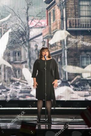 """Lisa Angell of France performs her Song """"N'oubliez pas"""" at the grand final show of the Eurovision Song Contest 2015"""