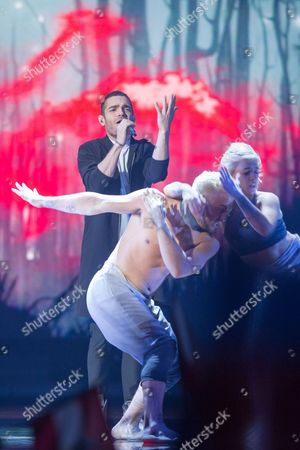 """Stock Photo of Elnur Huseynov of Azerbaijan performs his song """"Hour of the Wolf"""" at the grand final show of the Eurovision Song Contest 2015"""