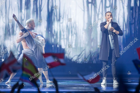 """Stock Image of Elnur Huseynov of Azerbaijan performs his song """"Hour of the Wolf"""" at the grand final show of the Eurovision Song Contest 2015"""
