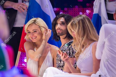 Polina Gagarina of Russia and Conchita Wurst at the grand final show of the Eurovision Song Contest 2015