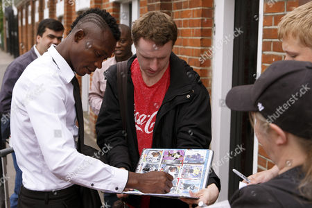 Fulham legend John Pantsil signs autographys for fans at the Shooting Stars Chase Cup 2015 - Celebrity match against Fulham Legends