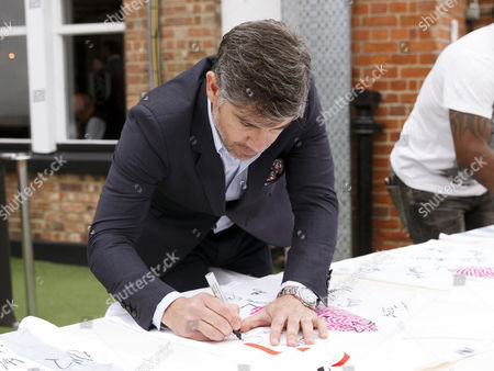 Paul Peschisolido signs shirts at the Shooting Stars Chase Cup 2015 - Celebrity match against Fulham Legends