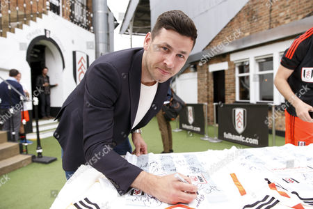 Boxer Darren Baker signs shirts at the Shooting Stars Chase Cup 2015 - Celebrity match against Fulham Legends