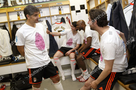 Fulham legend Paul Peschisolido and Maccabees guitarist Felix White in the dressing room at the Shooting Stars Chase Cup 2015 - Celebrity match against Fulham Legends