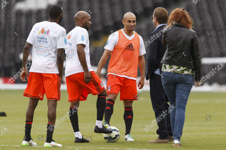 Danny Webber and DJ Spoony talking to Sean Bean at the Shooting Stars Chase Cup 2015 - Celebrity match against Fulham Legends