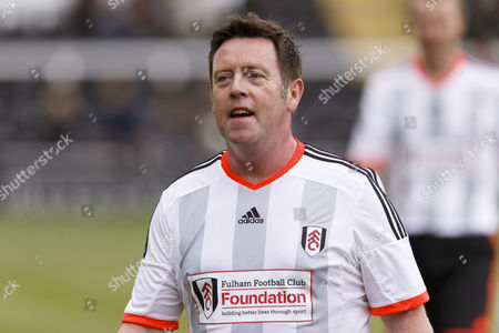 Stock Picture of Fulham Legend John Pantsil at the Shooting Stars Chase Cup 2015 - Celebrity match against Fulham Legends