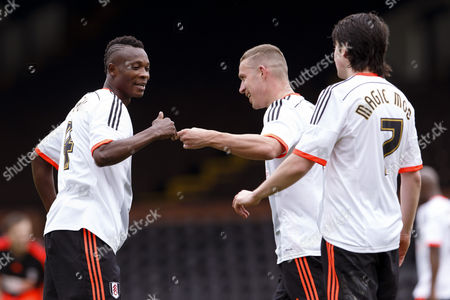 Stock Image of Fulham Legend John Pantsil celebrates with Sean Davis Shooting Stars Chase Cup 2015 - Celebrity match against Fulham Legends