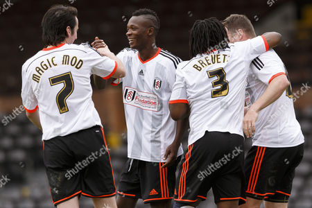 Fulham Legend John Pantsil celebrates with Magic Mod and Rufus Brevett at the Shooting Stars Chase Cup 2015 - Celebrity match against Fulham Legends