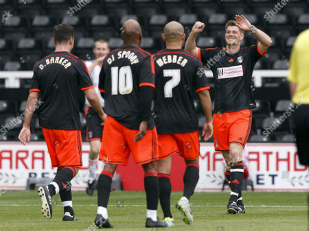 Fulham Foundation staff member Ryan Moore celebrates a goal with footballer Danny Webber , DJ Spoony and boxer Darren Barker at the Shooting Stars Chase Cup 2015 - Celebrity match against Fulham Legends