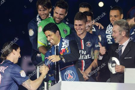PSG player's Zlatan Ibrahimovic (L) celebrates its French championship with the PSG president's Nasser Al Khelaifi in middle and the LFP president's Frederic Thiriez at the end of the Football French Championship game
