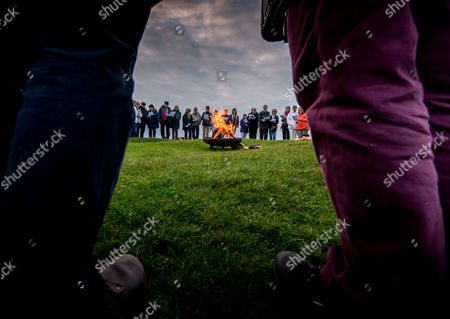 Lighting of Firle Beacon near Lewes, East Sussex, by Rev Peter Owen Jones. parishoners from the local deanery of Seaford joined Rev Peter Owen Jones as he lit the beacon at Firle