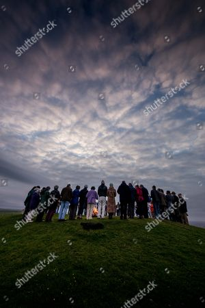 Stock Picture of Lighting of Firle Beacon near Lewes, East Sussex, by Rev Peter Owen Jones. parishoners from the local deanery of Seaford joined Rev Peter Owen Jones as he lit the beacon at Firle