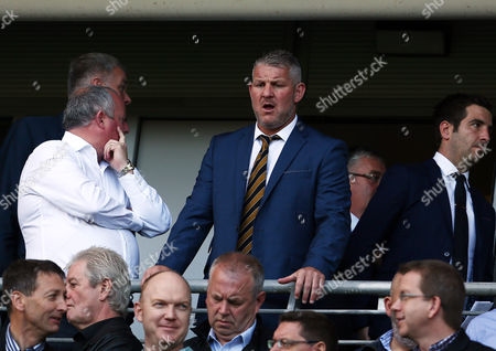 Former Hull City player Dean Windass looks on from the stand