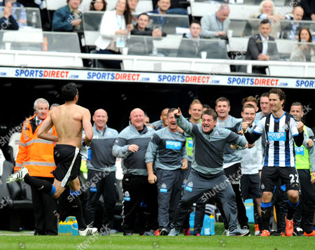 Jonas Gutierrez of Newcastle United celebrates scoring their second goal with Newcastle United head coach John Carver
