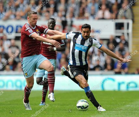 Jonas Gutierrez of Newcastle United (right) vies for the ball with Kevin Nolan of West Ham United