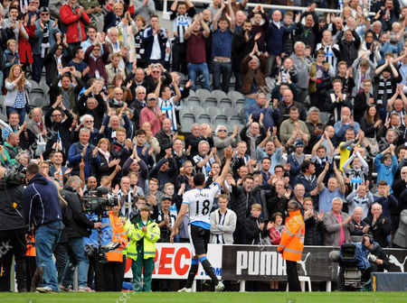 Jonas Gutierrez of Newcastle United gets a standing ovation as he goes off after the final whistle
