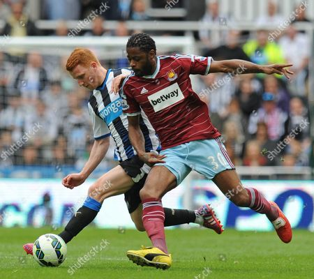 Jack Colback of Newcastle United (left) fends off Alexandre Song of West Ham United