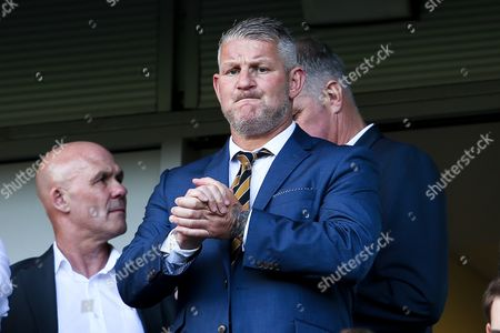 Former Hull City striker Dean Windass watches from the stands