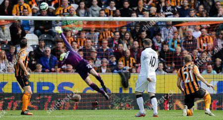 Hull City's Steve Harper saves a long range shot from Manchester United Captain, Wayne Rooney