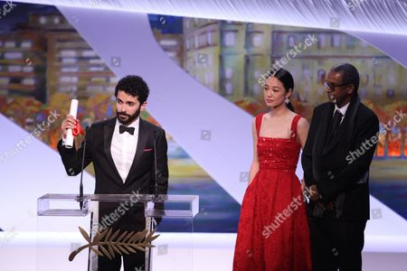 Ely Dagher speaks onstage after being awarded the Palme d'Or for his short film 'Waves '98'