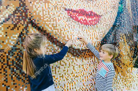 Evie Baker age 8 with Edward Davies age 5 putting finishing touches on the mosaic
