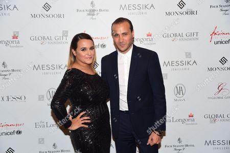 Stock Photo of Merwan Rim and wife
