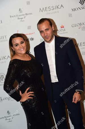 Stock Picture of Merwan Rim and wife