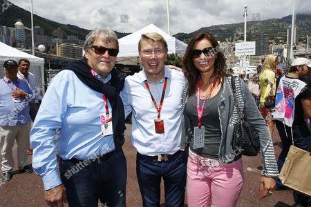 Stock Image of Norbert Haug (GER), Mika Hakkinen (FIN) and his girlfriend Marketa Kromatova