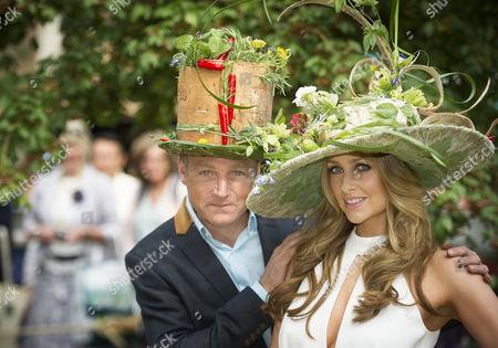 TV presenter Chris Beardshaw and Actress Gemma Merna wearing hats celebrating the medicinal properties of plants at RHW8 garden