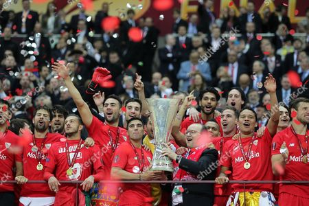 Sevilla club president Jose Castro Carmona, Carlos Arturo Bacca and Jose Reyes of Sevilla  a celebrate  winning UEFA Europa League Final 2015