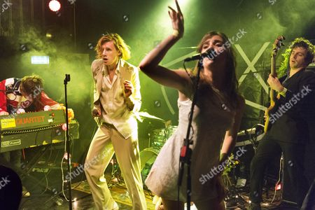 Foxygen - lead singer Sam France in white suit and Jonathan Rado to left on keyboards