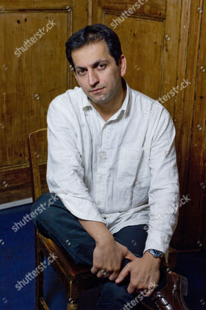 UK documentary maker Amir Amirani Photoshoot in Primrose Hill, London, Britain.
