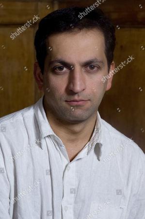 Stock Image of UK documentary maker Amir Amirani Photoshoot in Primrose Hill, London, Britain.