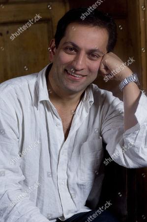 Stock Photo of UK documentary maker Amir Amirani Photoshoot in Primrose Hill, London, Britain.